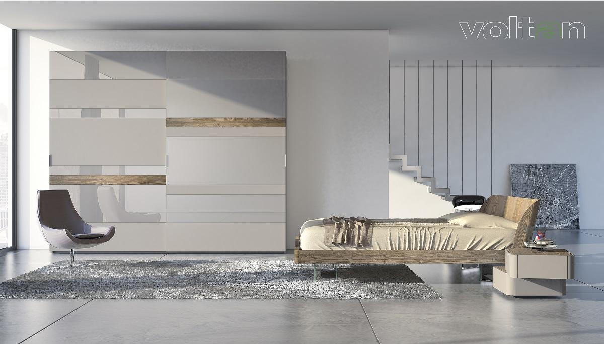 camera letto design grigia